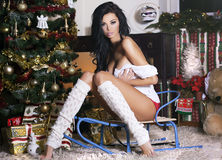 Brunette woman posing in christmas time. Royalty Free Stock Photography