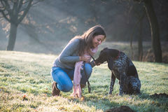 Brunette woman posing with her adorable German pointer dog Stock Photography