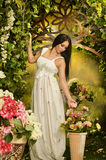 Brunette woman posing near floral decoration Royalty Free Stock Photo