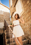 Brunette woman posing on old stairway at stone building Royalty Free Stock Photos