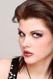 Brunette woman with purple lipstick Stock Photos