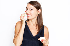 Brunette woman putting lotion on. Mid-adult tainted woman putting lotion on her face stock photo