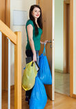 Brunette woman putting out the garbage Royalty Free Stock Photo