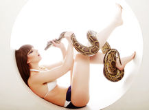 Brunette woman with python Royalty Free Stock Image