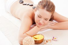 Brunette woman receiving spa stones therapy Stock Images