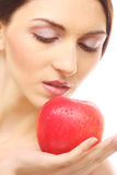 Brunette woman with red apple Royalty Free Stock Photos