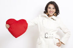 Brunette woman with red heart Stock Image