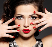 Brunette woman with red nails and makeup Royalty Free Stock Photography