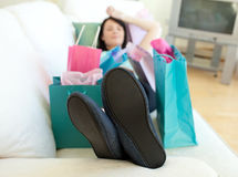 Brunette woman relaxing after shopping Stock Photo