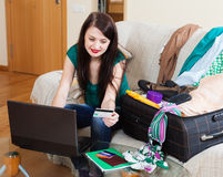 Brunette woman reserving hotel on the internet Royalty Free Stock Image
