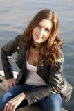 Brunette woman on riverbank Stock Photos