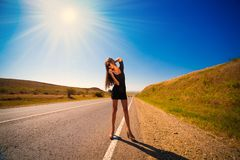 Brunette woman road Royalty Free Stock Image
