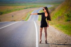 Brunette woman road Royalty Free Stock Photography