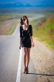 Brunette woman road Stock Photo