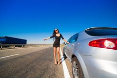Brunette woman road car Stock Images