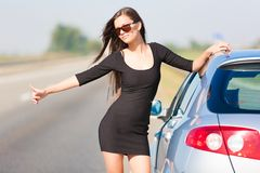 Brunette woman road car Stock Photo