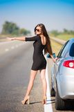 Brunette woman road car. Beautiful brunette woman road car travel background Royalty Free Stock Images