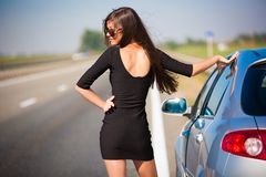 Brunette woman road car Stock Photos