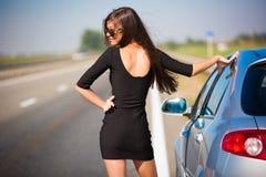 Brunette woman road car. Beautiful brunette woman road car travel background Stock Photos