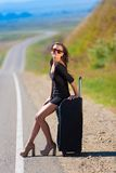 Brunette woman road suitcase Royalty Free Stock Photography