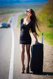 Brunette woman road suitcase Royalty Free Stock Images