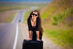 Brunette woman road suitcase Royalty Free Stock Photo