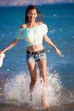 Brunette woman run sea Stock Image
