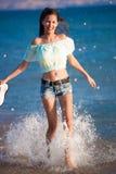 Brunette woman run sea Stock Image