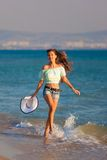 Brunette woman run sea Stock Photography