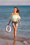 Brunette woman run sea Stock Photos