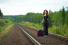 Brunette woman run after train Royalty Free Stock Images