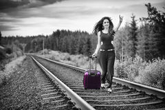 Brunette woman run after train Stock Photos