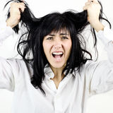 Brunette woman screaming for her messy hair. Woman desperate about her hair,unable to stylish them Stock Photos