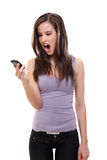 Brunette woman screaming at phone Stock Photography