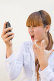Brunette woman screaming at phone. Image brunette woman screaming at phone Stock Image