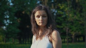 A brunette woman shows that she does not know what to do. Emotions, confusion. A brunette woman shows that she does not know what to do stock footage