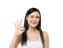 Brunette woman shows ok sign. Stock Photo