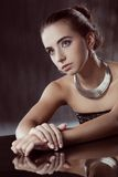 Brunette woman with silver jewellery Stock Images