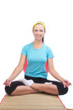 Brunette woman sitting on mat and doing yoga Royalty Free Stock Image