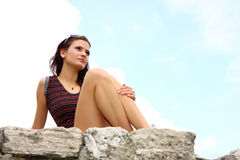 Brunette woman sitting outdoor Royalty Free Stock Photo