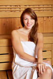 Brunette woman sitting in sauna Royalty Free Stock Image