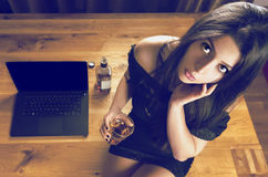 Brunette woman sitting on wooden office royalty free stock image