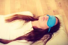 Brunette woman sleeping in blue eye sleep mask Stock Photo