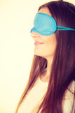 Brunette woman sleeping in blue eye sleep mask Royalty Free Stock Photography