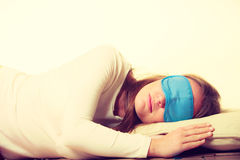 Brunette woman sleeping in blue eye sleep mask Stock Photo