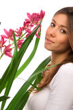 Brunette woman smelling purple orchid flower Royalty Free Stock Image