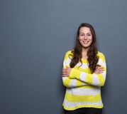Brunette woman smiling with arms crossed Royalty Free Stock Images