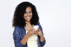 Brunette woman smiling with cell phone Stock Photos