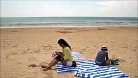 Brunette woman snaps selfie on tropical beach of Hainan island stock video footage