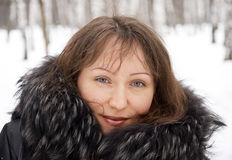 Brunette woman in snow winter park Stock Images